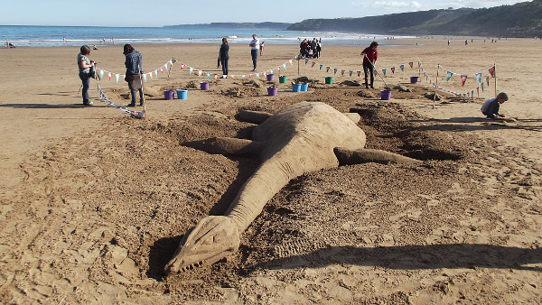 Newsletter Number 90 - A beached plesiosaur basking on the sand in sunny Scarborough